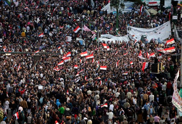 Anti-government protesters demand that President Hosni Mubarak step down at Tahrir Square on Feb. 10,...