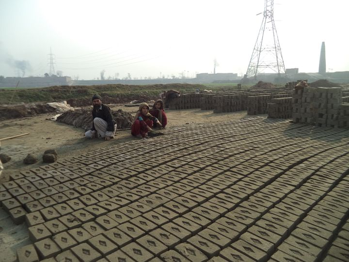 At many of Pakistan's brick kilns, men and their families are expected to work 10 hours a day. If it rains and they can't wor