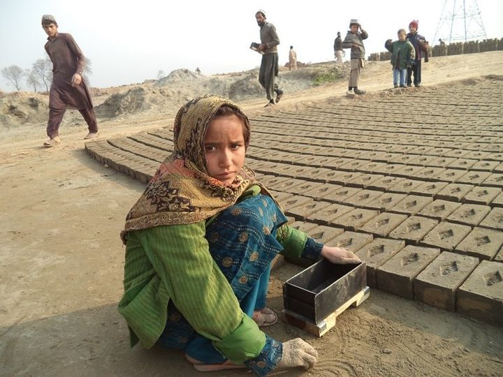 Qaseema, 8, started working at a brick kiln in Peshawar when she was 5 years old to help her father clear a debt that keeps g