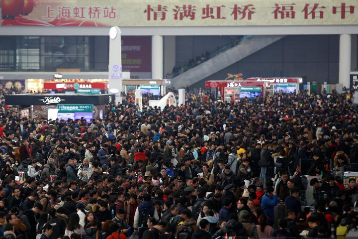 Passengers wait to board trains at Shanghai's Hongqiao Railway Station as hundreds of millions of Chinese travel home for Lun