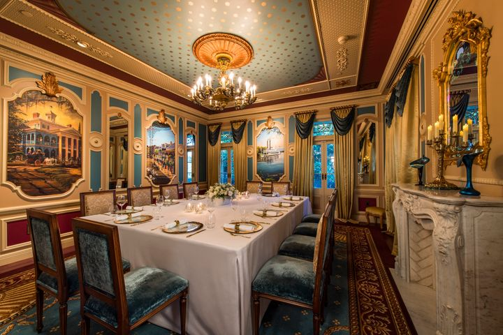 Dining room decor is based on Walt Disney's original plans for a private hangout in the park.