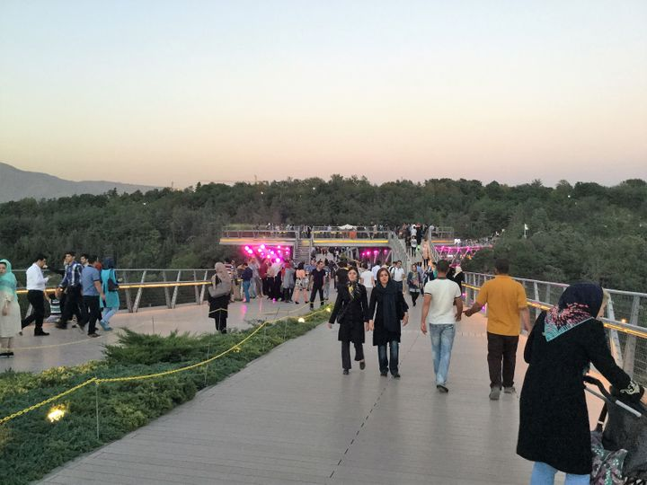 People enjoying a stroll on Tehran's Tabiat Bridge
