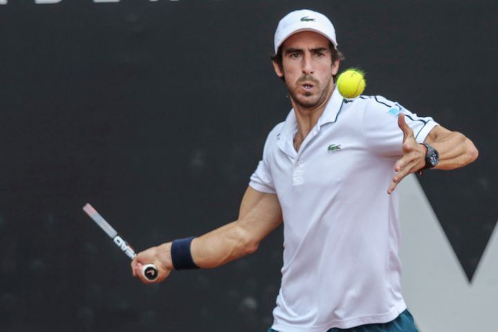Pablo Cuevas of Uruguay takes a forehand shot during a match against Pablo Carreño of Spain as part of Brasil Open 201