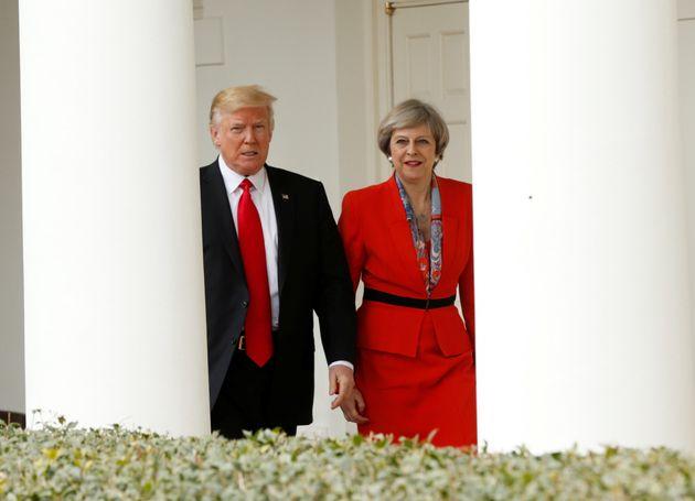 President Donald Trump 'escorts' Theresa Mayafter their meeting at the White