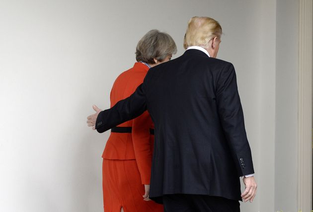 Trump and May walk to lunch after their meeting at the White