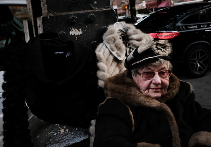 A woman sells fur jackets along a street in Brighton Beach, one of the largest Russian speaking enclaves in the Western Hemis
