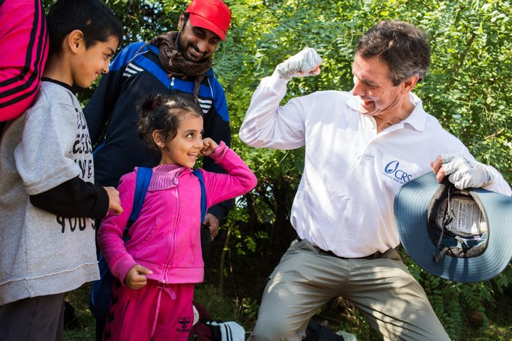 Sean Callahan, president and CEO for Catholic Relief Services, spends time with refugee children along the Serbia and Croatia