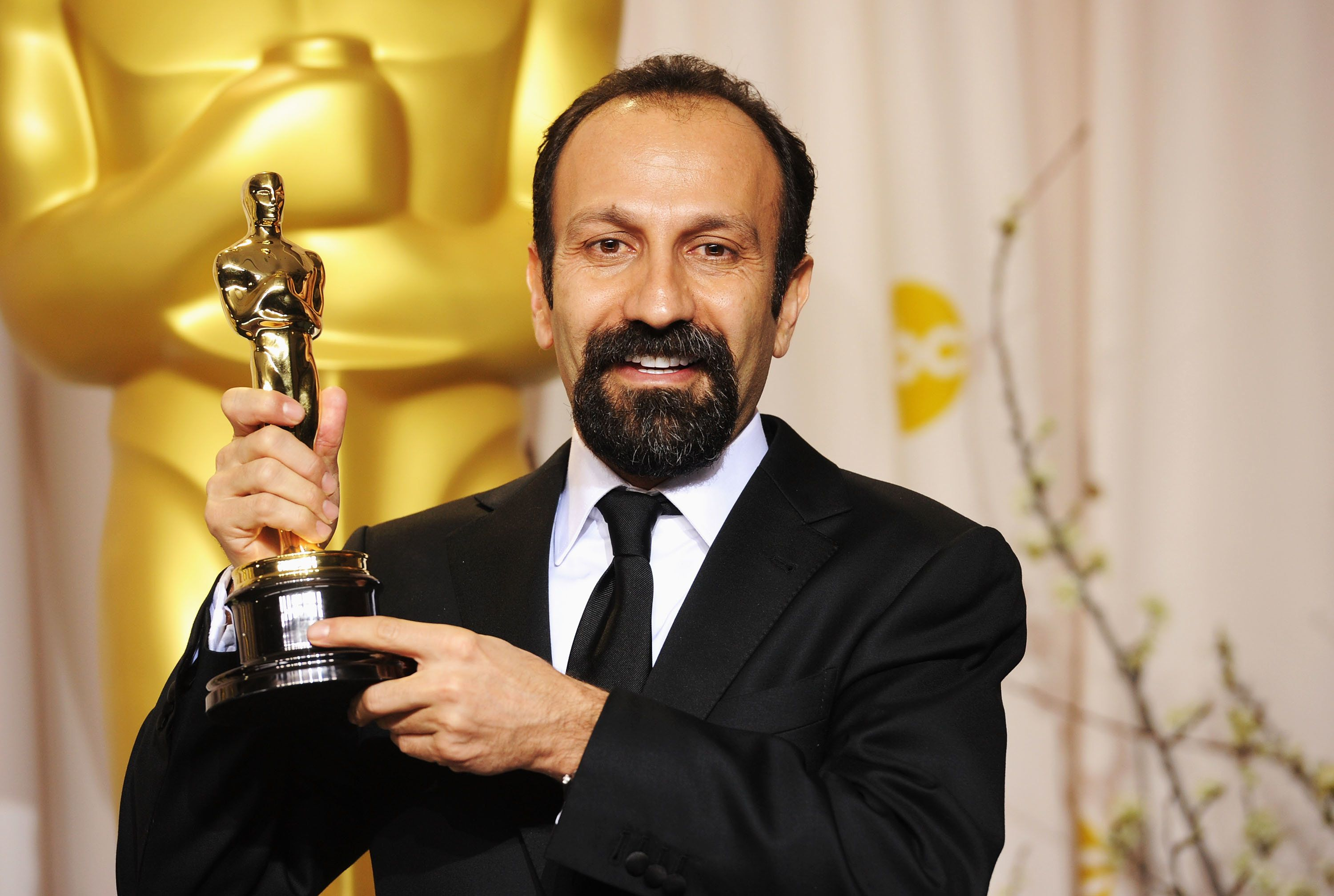 """Asghar Farhadi poses with his Academy Award for best foreign language film for """"A Separation""""in 2012."""