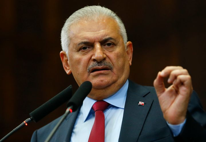 Turkish Prime Minister Binali Yildirim addresses members of Parliament in Ankara on July 19, 2016.