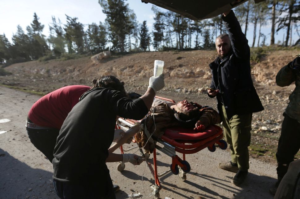 Medics tend to the wounds of a rebel fighter who was injured by a mine on the outskirts of al-Bab on Jan. 28.