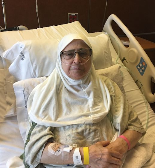 The mother of Nour Ulayyet and Sahar Algonaimi, recovering in a hospital bed Saturday.