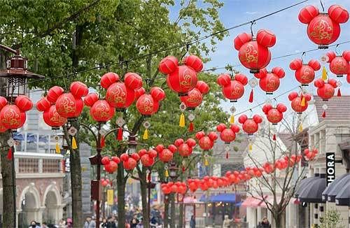 Mickey-shaped lanterns dangle over the streets of Disneytown, the Shanghai Disney Resort's shopping, dining & entertainment d