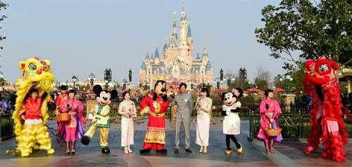 Philippe Gas (He's the one standing next to Goofy) — general manager of the Shanghai Disneyland Resort — presided over this m