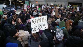 NEW YORK, UNITED STATES - JANUARY 28: Immigration activists stage a protest against President Donald Trump's 90-days ban of entry on 7 Muslim-majority countries in JFK airport in New York, U.S.A on January 28, 2017.  (Photo by Mohammed Elshamy/Anadolu Agency/Getty Images)