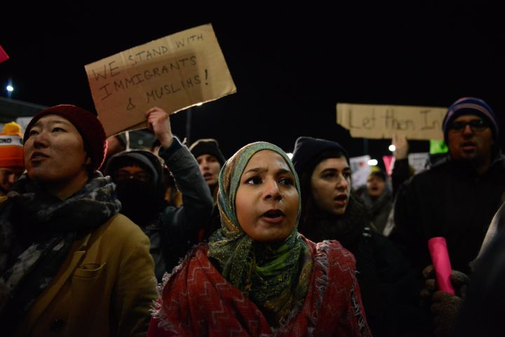 Protestors rally at JFK during a demonstration against President Donald Trump's new immigration ban.
