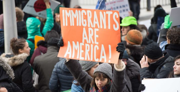 Protesters gather at JFK International Airport's Terminal 4 to demonstrate against President Donald Trump's executive order o