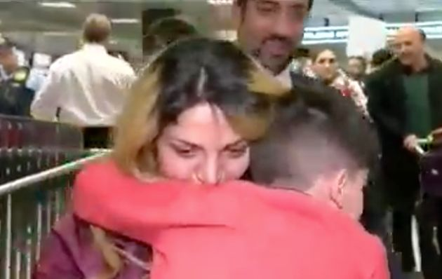 A women has been reunited with her son who was detained for hours at a Washington airport following Trump's...