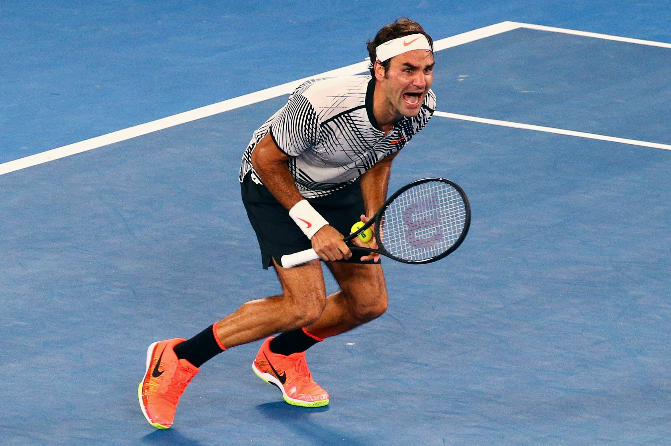 Tennis - Australian Open - Melbourne Park, Melbourne, Australia - 29/1/17  Switzerland's Roger Federer celebrates winning his Men's singles final match against Spain's Rafael Nadal. REUTERS/David Gray  TPX IMAGES OF THE DAY
