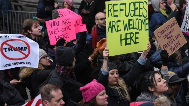 Americans gathered in airports around the country to protest Trump's order barring refugees and Muslim