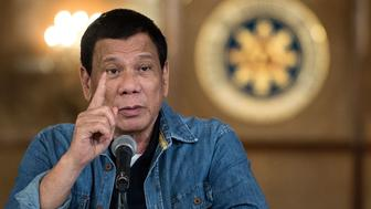 Philippine's President Rodrigo Duterte gestures as he answers a question during a press conference at the Malacanang palace in Manila on January 30, 2017.  Philippine's President Rodrigo Duterte on January 30, 2017 extended his deadly drug war until the last day of his term in 2022, but conceded the police force acting as his frontline troops was 'corrupt to the core'. Thousands of people have died in the crackdown that began when Duterte took office in the middle of last year, with rights groups warning police are carrying out extrajudicial killings not just to fight crime but to aid their own corrupt activities. / AFP / NOEL CELIS        (Photo credit should read NOEL CELIS/AFP/Getty Images)