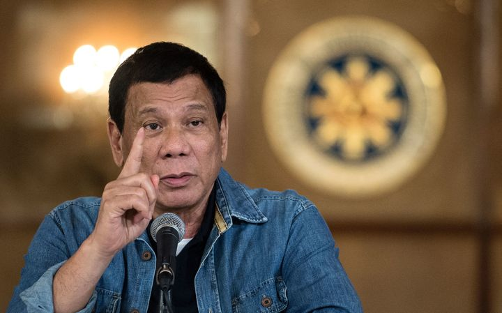 Philippine's President Rodrigo Duterte gestures as he answers a question during a press conference at the Malacanang palace i