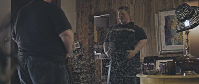 Tom (Merrick Robison) checks himself outin the mirror in a scene from<em><strong>Empty Space</strong></em>
