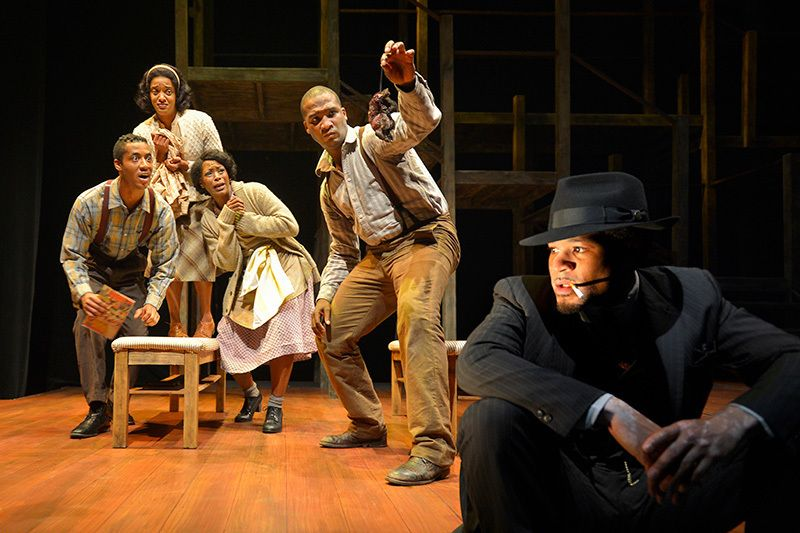 Black Rat (William Hartfield) eavesdrops on a scene with Bigger's family in a scene from <strong><em>Native Son</em></strong>