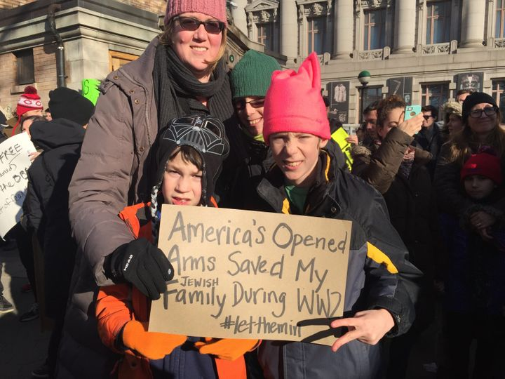 Rabbi Alysa Mendelson Graf and her sons at the protest in Battery Park in New York City.