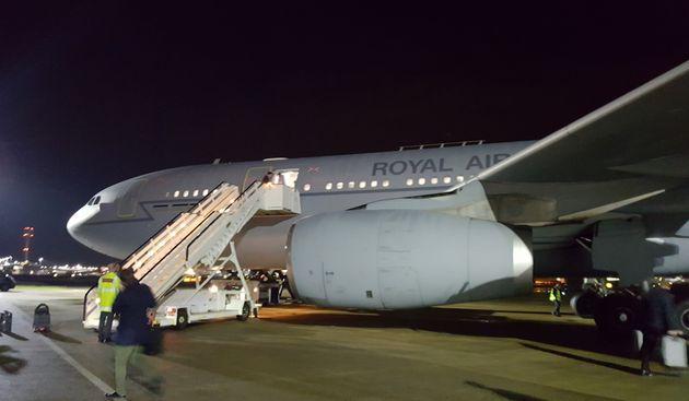 Theresa May's RAF Voyager unloads at