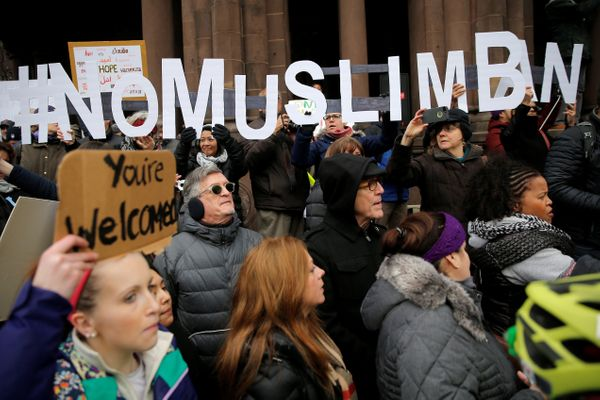 "Demonstrators spell out ""# No Muslim Ban"" during the protest in Boston."