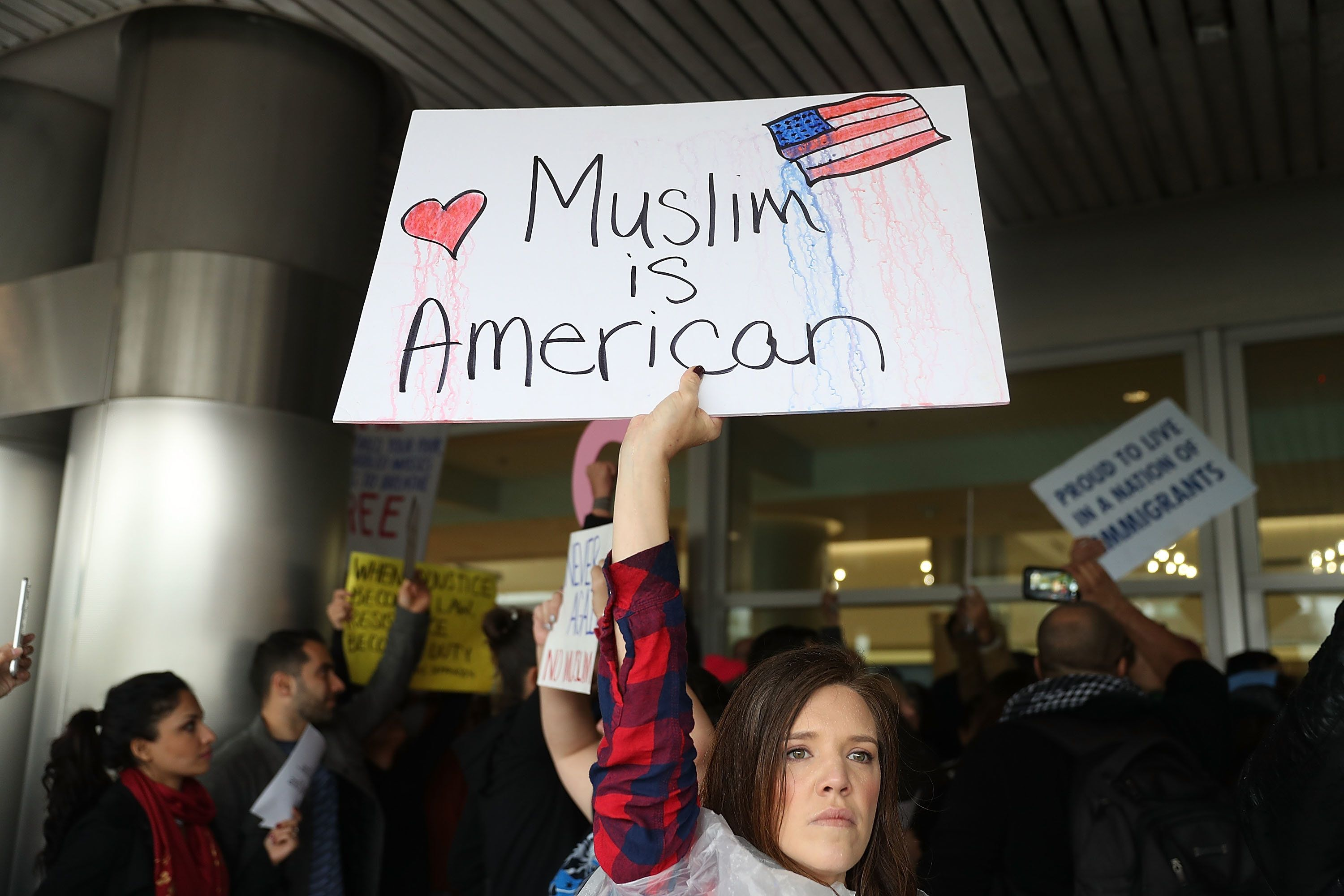 Tristan Houghton protests atMiami International Airport Sunday.