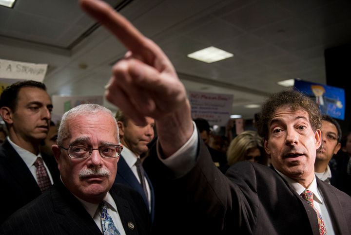 Rep. Gerry Connolly (D-Va.) and Rep. Jamie Raskin (D-Md.) speak to the press and protesters at Dulles International Airport i