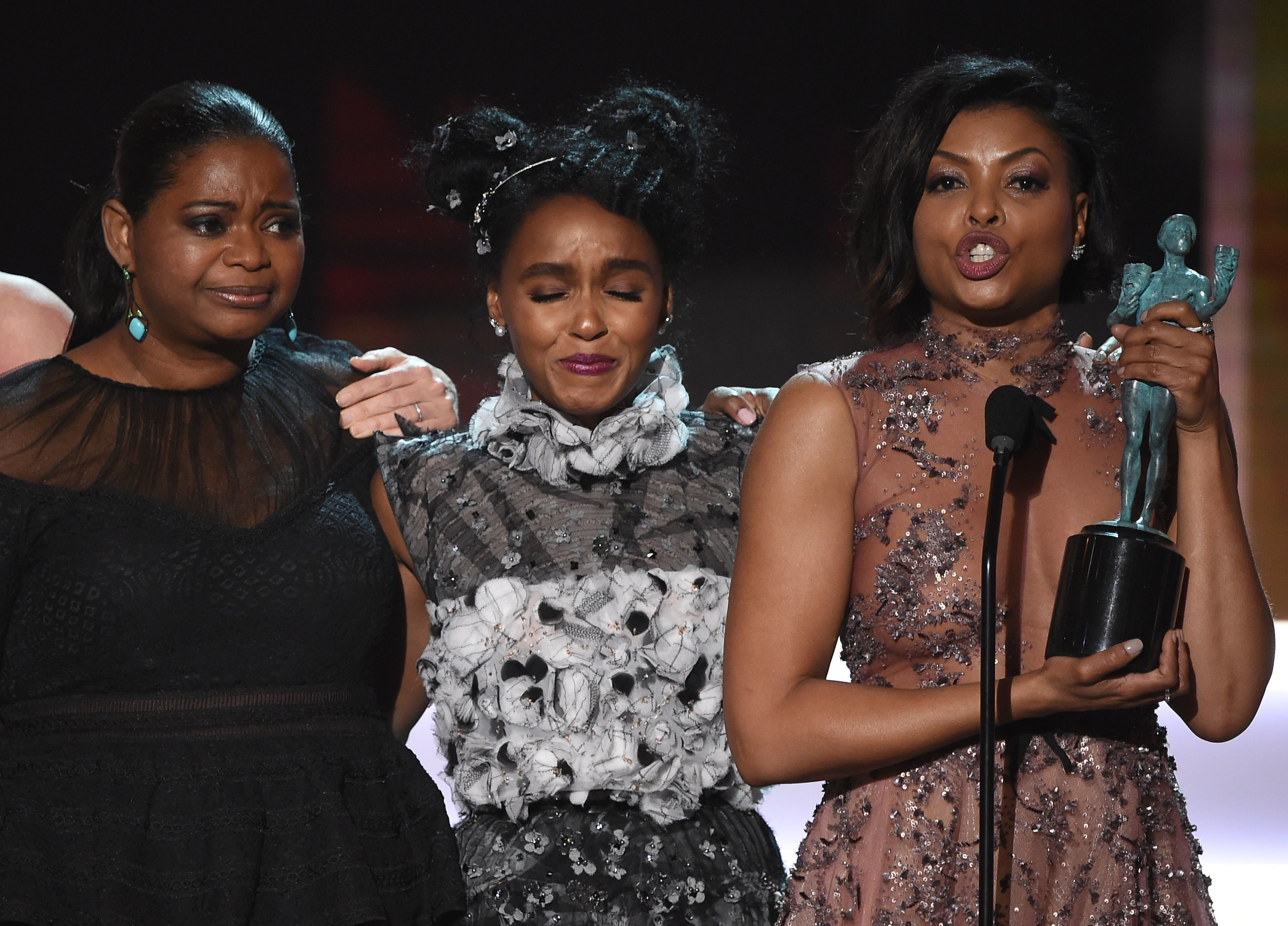 (L-R) Actress Octavia Spencer,  Janelle Monae, and Taraji P. Henson accept the award for Outstanding Performance by a Cast in a Motion Picture for 'Hidden Figures' during the 23rd Annual Screen Actors Guild Awards show at The Shrine Auditorium on January 29, 2017 in Los Angeles, California. / AFP / Robyn BECK        (Photo credit should read ROBYN BECK/AFP/Getty Images)