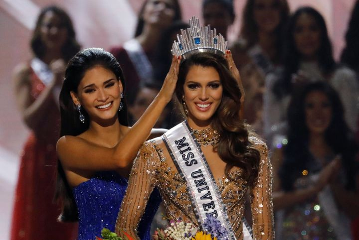 Pia Wurtzbach, left, places the crown on Miss France Iris Mittenaere after the latter was declared winner in the Miss Universe beauty pageant on Monday.