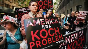 NEW YORK, NY - JUNE 05:  Activists hold a protest near the Manhattan apartment of billionaire and Republican financier David Koch on June 5, 2014 in New York City. The demonstrators were protesting against the campaign contributions by the billionaire Koch brothers who are owners of Koch Industries Inc. The brothers have become a focus of Democrats and liberals as they are accused of skewing the political playing field with their finances.  (Photo by Spencer Platt/Getty Images)