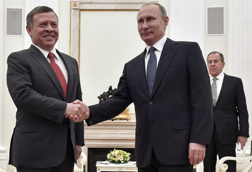 Russian President Vladimir Putin, right, shakes  hands with Jordan's King Abdullah II during their meeting in the Kremlin in