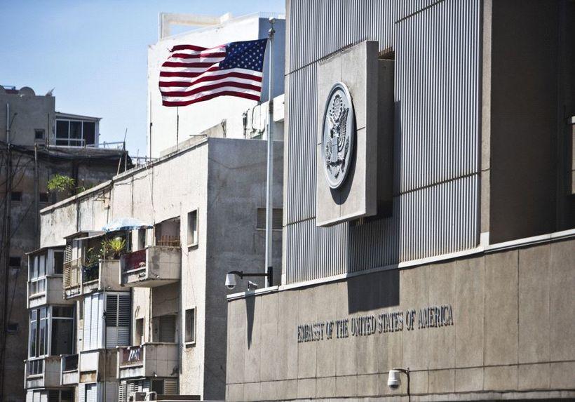 A flag flutters outside the U.S. embassy in Tel Aviv, Israel, August 4, 2013.