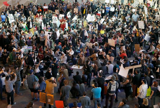 Demonstrators gather atat Los Angeles International Airport to protest agsainst the