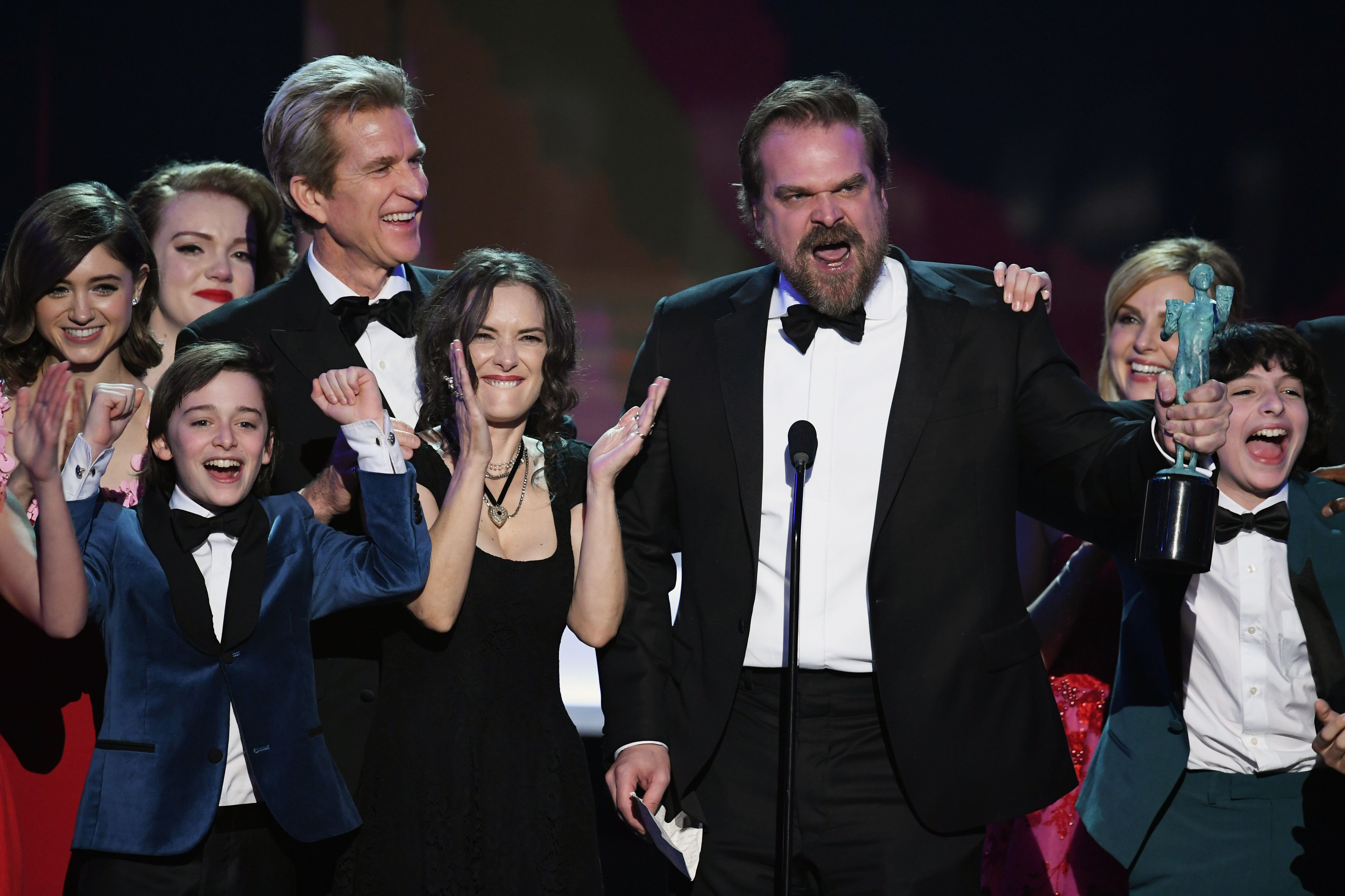 LOS ANGELES, CA - JANUARY 29:  (L-R) Actors Natalia Dyer, Shannon Purser, Matthew Modine, Noah Schnapp, Winona Ryder, David Harbour, Cara Buono, and Finn Wolfhard  of 'Stranger Things' accept Outstanding Performance by an Ensemble in a Drama Series  onstage during The 23rd Annual Screen Actors Guild Awards at The Shrine Auditorium on January 29, 2017 in Los Angeles, California. 26592_014  (Photo by Kevin Winter/Getty Images )