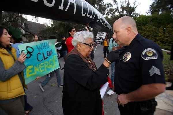 <strong>ACCE activist Beverly Roberts talks with San Marino police Sgt. Robert Matthews</strong>  at protest in front of Well
