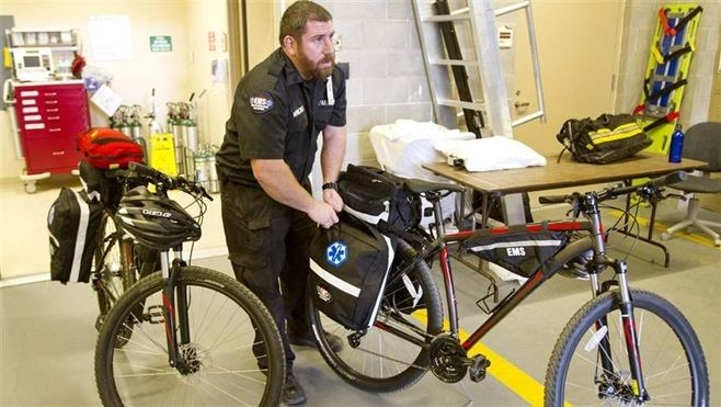 Paramedic Ryan Winchell of West Park Hospital EMS shows off mountain bikes used by the hospital's Bike EMS Team in Cody, Wyom