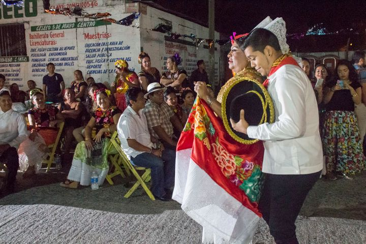 "Jesusa Hernandez Noriega, left, the ""Queen of Queens,"" paraded to the festival stage alongside her dance partner."
