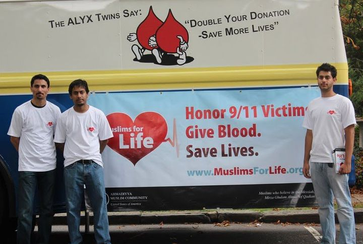 With Muslim youth in front of a blood mobile at one of many blood drives across the country.