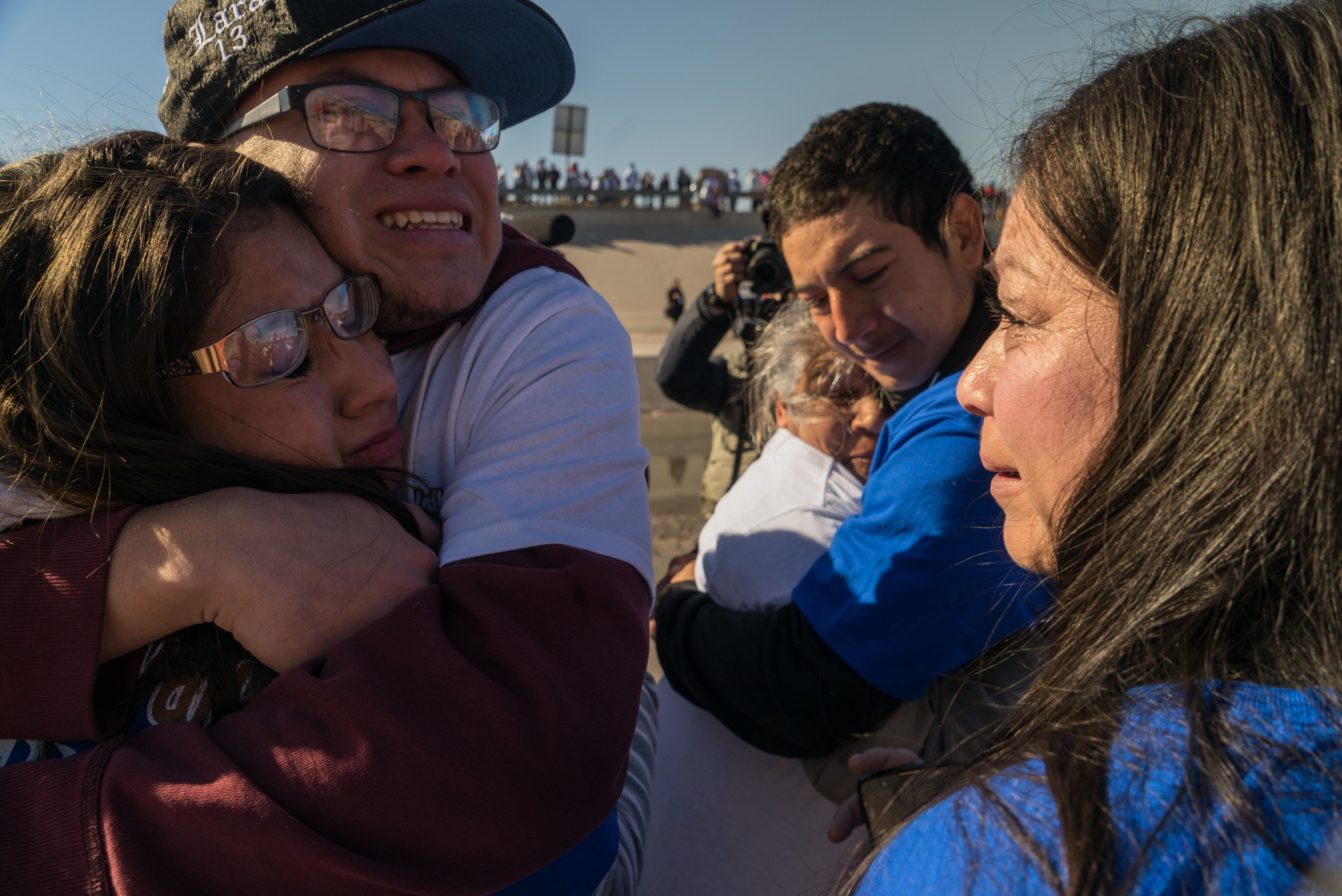 Mexican residents hug relatives residing in the United States during a 'Hugs Not Walls' event temporarily reuniting relatives at the U.S. and Mexico border in Juarez, Mexico, on Saturday, Jan. 28, 2017. Mexican President Enrique Pena Nieto and U.S. President Donald Trump agreed to stop publicly talking about who would pay for a border wall during a phone call Friday, representatives of both governments said, putting at least a partial lid on a feud that has threatened to rupture one of the world's biggest bilateral trade relationships. Photographer: Cesar Rodriguez/Bloomberg via Getty Images