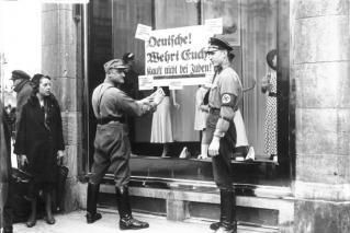 Stores owned by Jews were marked in Germany, leading to the Night of Broken Glass in which hundreds of synagogues and over 75