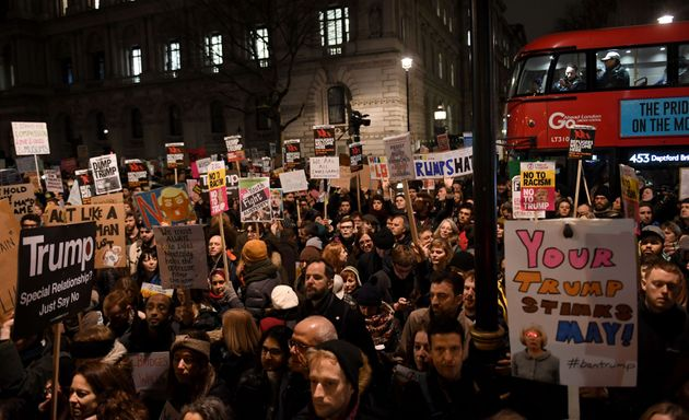 People demonstrate during a protest at Downing Street in central London against US President Donald Trump's...