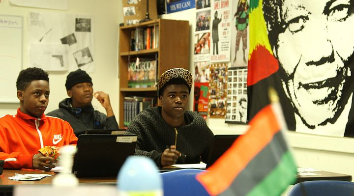 Tenth grade Manhood Development class students at Oakland High absorb a discussion about college admissions.