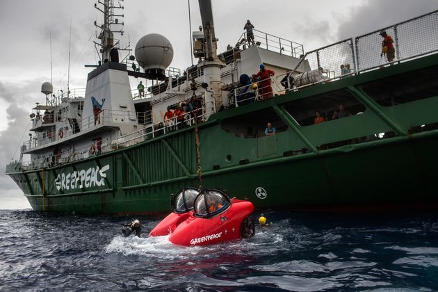 Oceanographers take off in submarine launched from Greenpeace ship MY Experanza off the coast of...