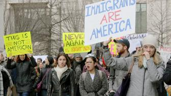 People holding placards march at a rally around the White House in Washington on Jan. 29, 2017, following an executive order issued two days earlier by U.S. President Donald Trump to suspend the entry of travelers from seven Muslim-majority countries for 90 days and that of refugees from any country for 120 days. (Photo by Kyodo News via Getty Images)