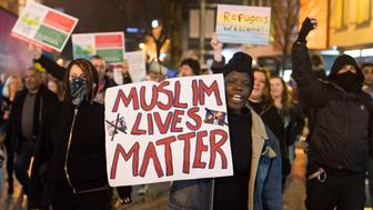 CARDIFF, WALES - JANUARY 30: A woman holds a sign that reads 'Muslim Lives Matter' during a protest on Queen Street following US President Donald Trump's ban on people from seven Muslim-majority countries entering the US on January 30, 2017 in Cardiff, Wales. President Trump signed an executive order on Friday banning immigration to the USA from seven muslim countries. This led to protests across America and, today, the UK.  A British petition asking for the downgrading of Trump's State visit passed one million signatures this morning.  (Photo by Matthew Horwood/Getty Images)